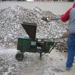 Crushing shells for river lawn path.