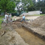 Trenching to discover drive and paths.
