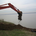 Filling in erosion on the bank.