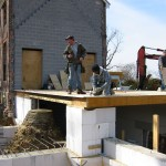 Laying floor for east wing frame addition.