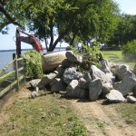 Bolders to stabilize bank near Cottage.